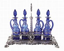Portuguese silver cruet stand with 4 blue glass bottles.