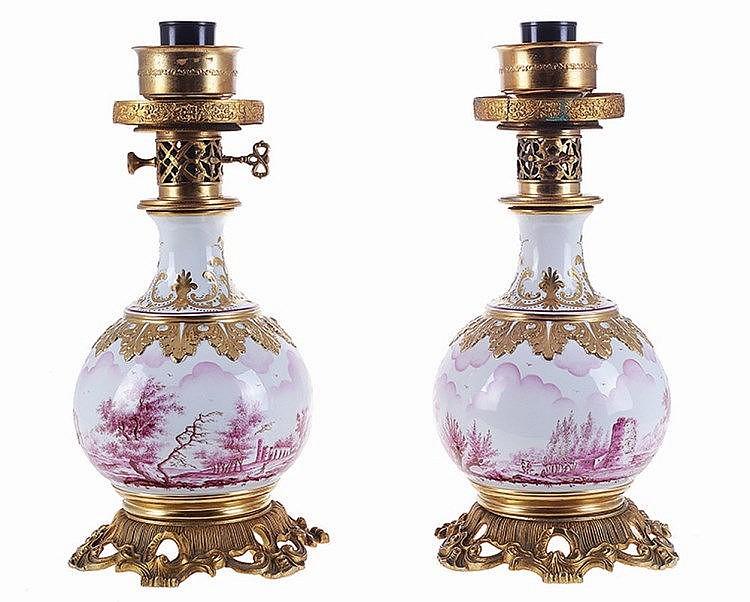European porcelain pair of table lamps.
