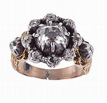 Gold and silver ring set with: 1 brilliant cut diamond with approx: 1 Kts, 2 with 0,30 Kt.
