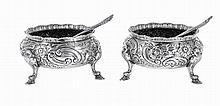 English silver pair of salt-cellars with two spoons.Hallmarked.