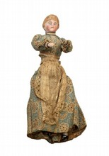 ANTIQUE PORCELAIN DOLL OF WOMAN IN DRESS