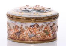 1920's Capodimonte porcelain box.  Youthful cherubs ser