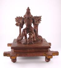 Antique Garuda wood carving Vahana of Lord Vishnu with articulated/rotating shoulders, elbows, and hands.  Similar specimens of this quality and detail reside in the National Museum of Delhi, India.  Vahanas are mythical carriages or vehicles of the Hindu Gods and life-sized or large versions of Vahanas are especially used to mount the movable images of deities. In southern India, especially Tamil Nadu, annual religious festivals that last from a week to ten days involve the parading of deities mounted on a vehicle around the temple.  In Hinduism, Garuda is a Hindu divinity, usually the mount (Vahana) of the Lord Vishnu. Garuda is depicted as having the golden body of a strong man with a white face, red wings, and an eagle's beak and with a crown on his head. This ancient deity was said to be massive, large enough to block out the sun.  Garuda is known as the eternal sworn enemy of the Naga serpent race and known for feeding exclusively on snakes, such behavior may have referred to the actual short-toed eagle of India. The image of Garuda is often used as the charm or amulet to protect the bearer from snake attack and its poison, since the king of birds is an implacable enemy and