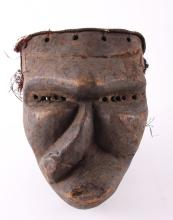 African Pende wood Mbangu sickness mask.  These masks are used to entertain a community during non-ritual festivities. Once used during mukanda initiation ceremonies to mark the end of male circumcision rituals, mbuya masquerades are now used to highlight a number of characters and roles in Pende society.  The mbangu mask depicts someone that is bewitched, diseased or handicapped due to their moral corruption (some sources point to bewitchment caused by a jealous rival inflicting disease). It is believed that scars are borne by the inflicted falling into a fire after an epileptic fit.  Provenance: Private collection collected between 1910 and 1930.   SIZE: see attached ruler photo.  Photos are part of the description representing the condition report and can be used for authentication prior to the sale date.  Pangaea Auctions urges Bidder's to view all attached photos in detail.  #(African, 19th-20th Century, Fine Art- Sculpture, Mask, Wood, Antique, Vintage, ).
