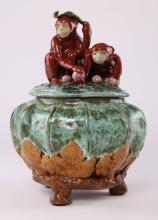Cookie jar depicting two playful monkeys holding fruit and a leaf atop a green glazed pot wrapped in brown Maple leaves and tree branches.  SIZE: see attached ruler photo.  Photos are part of the description representing the condition report and can be used for authentication prior to the sale date.  Pangaea Auctions urges Bidder's to view all attached photos in detail.  #(American, 19th-20th Century, Pottery, Jar, Ceramic/Porcelain, Vintage, ).