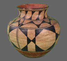 Santo Domingo Pottery, 19th/20th Century, Native American Indian.  Large & beautiful upright pottery water jar done in polychrome with stylized foliate and geometric designs.  Museum tag 317 (on bottom) from Seminole exhibition.  Certificate of
