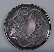 Rose Gonzales (1900-1989), a very rare San Ildefonso Pueblo Incised Blackware Pottery Plate of traditional form, decorated with a deeply incised avanyu (