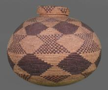 Native American or Oceanic bottleneck weaved basket from early 1900's, finely shaped and tightly woven. Early 1900's from Seminole Chief Joe Dan Osceola's museum collection. Measurements 14 (in) x 18(in). A very significant Native American artifact