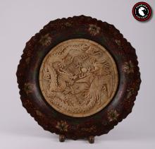 Antique Asian cloisonn? plate with hand-carved bone. Depicting Phoenix and Dragon, Symbol of Rebirth and the Cycle of the New Year.  SIZE: see attached ruler photo.  Photos are part of the description representing the condition report and can be used for authentication prior to the auction date.  Pangaea Auctions urges Bidder's to view all attached photos in detail.  #(Asian, Antique, Fine Art- Sculpture, Plate, Wood, , )