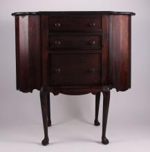 American Martha Washington mahogany sewing table, 19th Century.  Square top flanked by two lift top storage bins, centering three graduated drawers, reeded legs(Size: See second photo for measurement.)  Photos are part of the description representing the condition report.  Pangaea Auctions urges Bidder's to view all attached photos.