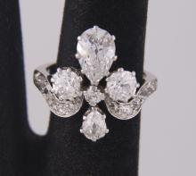 Pre World War I antique ladies custom platinum ring weighs 4.09 dwt. with 3.75cts total diamonds.  Ring Size: 5.25.  (See Photograph of appraisal.)  Set with 2 pear shaped diamonds with open culet est. weight 1.25cts.  The other est. weight 0.40cts flanked by 2 antique cut round diamonds open culets total weight est. 1.35cts VS2-SI1-SI2-G-H-I color and 15 old mine cut diamonds est. total weight 0.75cts very unique design diamonds.  Photos are part of the description representing the condition report.  Pangaea Auctions urges Bidder's to view all attached photos.