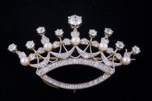 Platinum and 18kt yellow gold antique Royal Crown Pin weighs 7.74dwt.  Size: 2.5 inches in diameter.  Set with 54 antique cut diamonds with open culets est. weight 5.85ct.  The top is accented with 8 diamonds on post est. weight 1.75cts.  The center diamond est. weight 0.85cts total est. weight of diamonds 5.85cts plus 5 white pearls 3.50mm each.  Condition Report:  One small diamond is missing.  Photos are part of the description representing the condition report.  Pangaea Auctions urges Bidder's to view all attached photos.