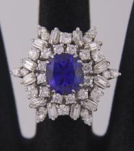 Beautiful 4.34cts VS2 tanzanite platinum diamond ring.  Contains twelve straight baguette cut diamonds and thirty round brilliant cut diamonds est. weight 2.5cts with VS and G-H color.  Weight is 14.3 grams.  Ring Size: 6 (See Photograph of appraisal.)  (Photos are part of the description representing the condition report.  Pangaea Auctions urges Bidder's to view all attached photos.