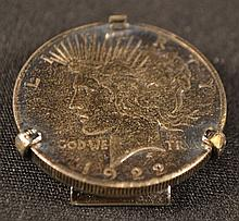1922 Peace silver dollar mounted in a Swank metal money clip frame