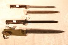 Two Norway Krag-Jorgenson model 1894 bayonets: one matching serial #38092 with blade stamped OEWG and steel scabbard; the other with muzzle ring added, steel scabbard with canvas frog