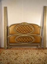 French carved, painted and upholstered bedstead