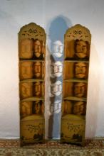 Pair of Asian stencil decorated curio shelves, 73