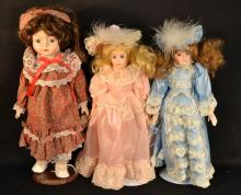 3 assorted dolls