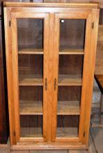 Oak two door bookcase, 57