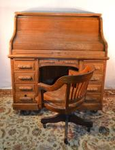 Oak serpentine roll top double pedestal desk with fitted interior and locking drawers; desk chair