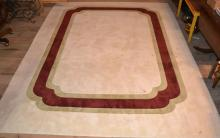 Machine made room size rug with padding 9'x12'