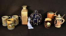 9 Continental pottery decorative objects: jar with lid, pitcher, vase, 2 steins, duck figure, etc.