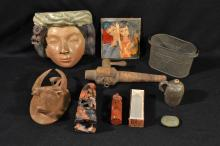 Collection of pottery, wood, metal, and stone objects