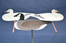 Three goose silhouette decoys, one signed Charles Bryan