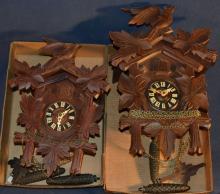 Two wood carved cuckoo clocks, as is
