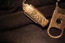 Watch FOB cigar cutter, motif of zeppelin, bi-plane and ship circa 1910