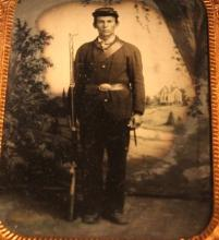 Civil War quarter plate ambrotype of an armed solider