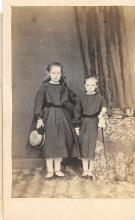 Young girls holding a doll, books, CDV, 1860s