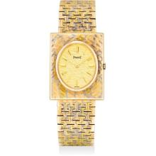 PIAGET - A fine and rare three-color gold rectangular bracelet watch with champagne dial, 1961