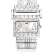 PIAGET - A lady's fine and rare white gold and diamond-set rectangular bracelet watch with mother-of-pearl dial, Circa 2010
