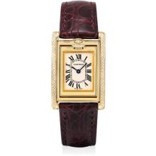 CARTIER - A lady's fine and rare yellow gold and diamond-set rectangular reversible wristwatch, Circa 2008