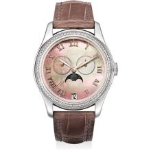 PATEK PHILIPPE - A lady's fine and rare white gold and diamond-set annual calendar wristwatch with sweep centre seconds, moon phases and mother-of-pearl dial, 2008