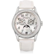 PATEK PHILIPPE - A lady's fine and rare white gold and diamond-set annual calendar wristwatch with sweep centre seconds, moon phases and mother-of-pearl dial, Circa 2008