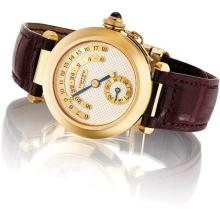 CARTIER - A fine and rare yellow gold limited edition jump hour wristwatch with day and night indicator, Circa 1998