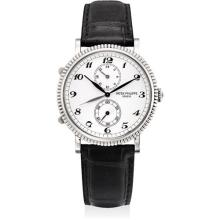 PATEK PHILIPPE - A fine white gold dual time wristwatch with 24 hours and Breguet numerals, 2000