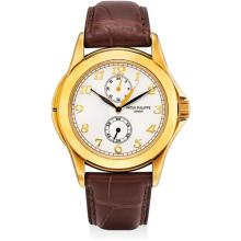 PATEK PHILIPPE - A fine and rare yellow gold dual time wristwatch with 24 hours and Breguet numerals, 2002