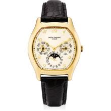 PATEK PHILIPPE - A fine and rare yellow gold tonneau-shaped perpetual calendar wristwatch with moon phases, 24 hours, leap year indication and Breguet numerals, 1993