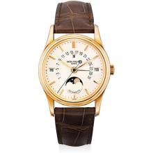 PATEK PHILIPPE - A fine and rare pink gold perpetual calendar wristwatch with sweep centre seconds, retrograde date, moon phases, leap year indicator, additional case back and original certificate, Circa 1997