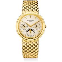 PATEK PHILIPPE - A fine and rare yellow gold perpetual calendar bracelet watch with moon phases, leap year indicator, 24 hours, original certificate and sales invoice, Circa 1989