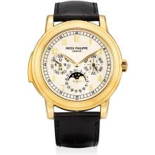 PATEK PHILIPPE - A very fine and very rare yellow gold minute repeating perpetual calendar wristwatch with moon phases, 24 hours, leap year indicator, additional case back, original certificate and fitted presentation box, 2001