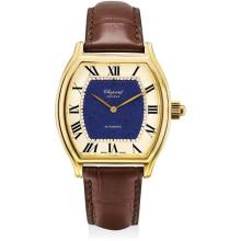 CHOPARD - A fine and unique yellow gold tonneau-shaped wristwatch with concealed automata of a man playing polo and lapis lazuli dial, 1997