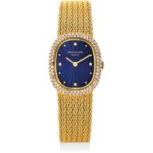 PATEK PHILIPPE - A lady's fine and rare yellow gold and diamond-set cushion-shaped bracelet watch with blue guilloché enamel dial, 1982