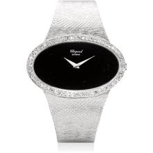 CHOPARD - A fine and rare white gold and diamond-set oval bracelet watch with onyx dial, 1971