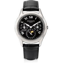 PATEK PHILIPPE - A fine and rare white gold limited edition perpetual calendar wristwatch with moon phases, 24 hours, leap year indicator and original certificate, Circa 1996