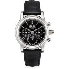 PATEK PHILIPPE - A fine and rare white gold perpetual calendar split seconds chronograph wristwatch with moon phases, 24 hours, leap year indicator, rare glossy black dial, original certificate, additional case back and fitted presentation box, 2001