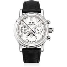 PATEK PHILIPPE - A fine and rare platinum perpetual calendar split-seconds chronograph wristwatch with moon phases, leap year indicator, additional case back and folding deployant clasp, original certificate and fitted presentation box, 2002
